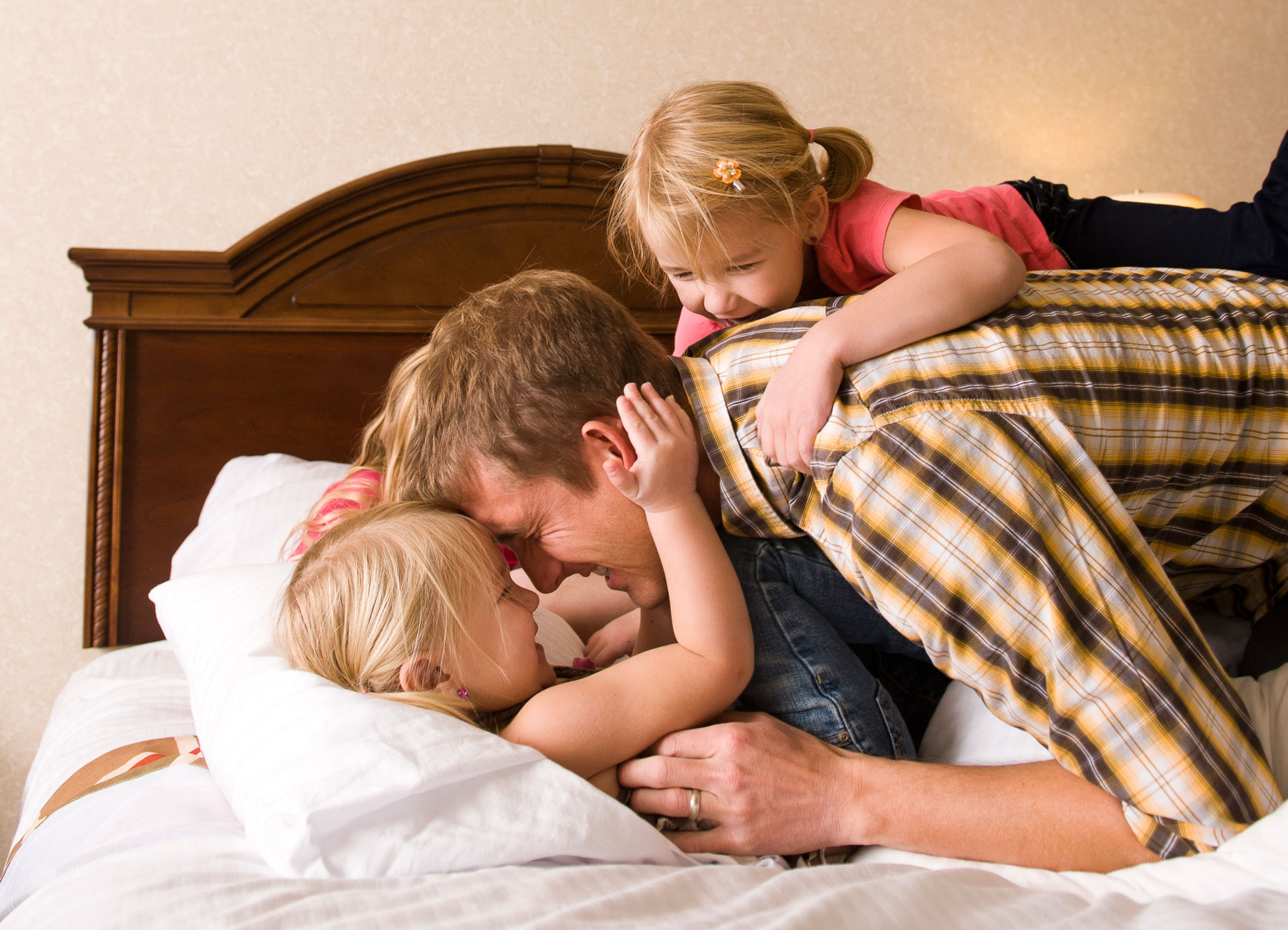 Active Lifestyle-Family having fun and laughing on bed