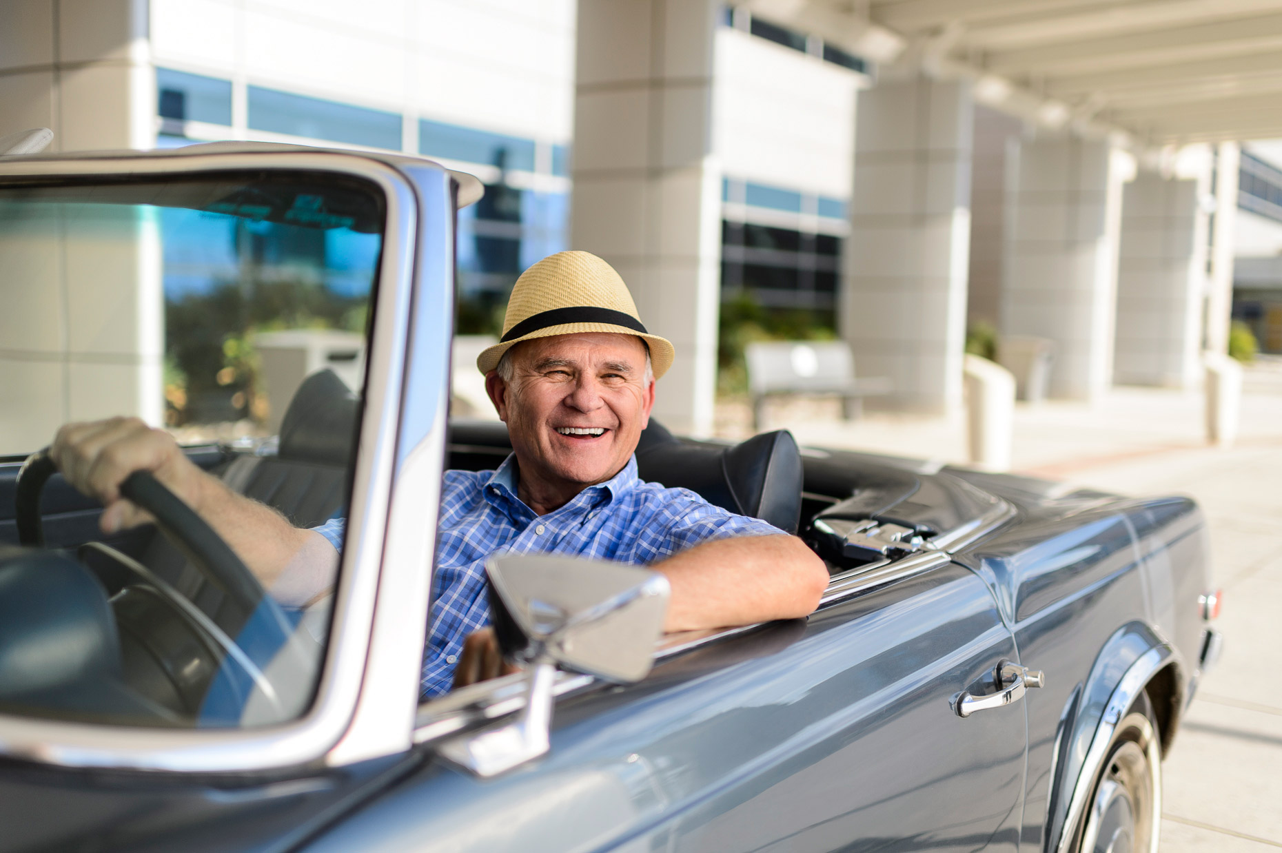 Active Lifestyle Photography - Older man driving a car
