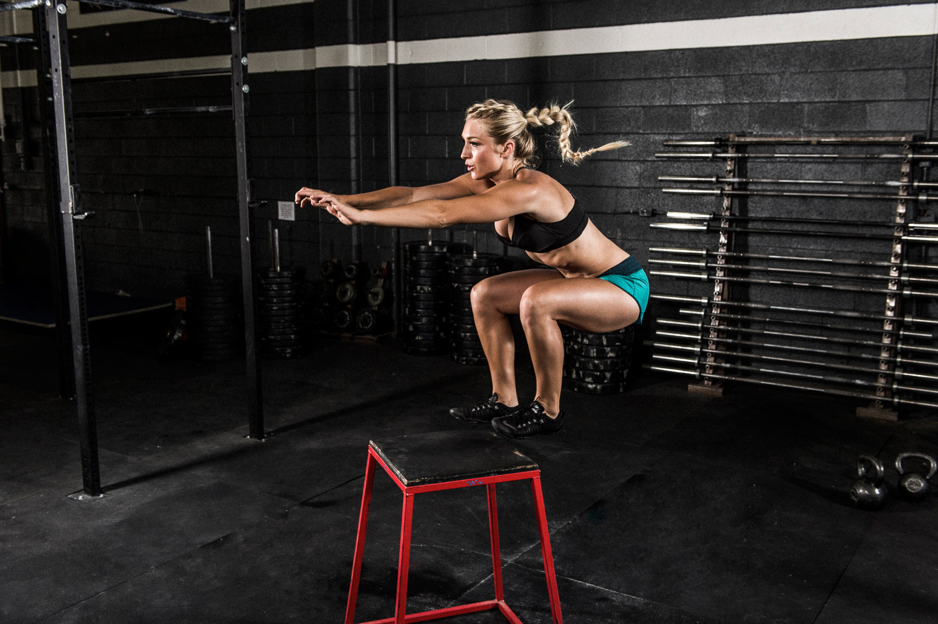 Sports Photography -Fit Female Jumping High in Gym Zija